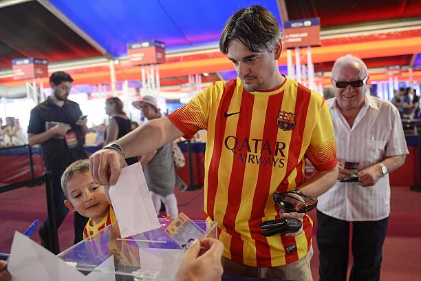 FC Barcelona's supporter casts his ballot during the FC Barcelona's president elections at the Camp Nou stadium in Barcelona on July 18, 2015. AFP PHOTO/JOSEP LAGO (Photo credit should read JOSEP LAGO/AFP via Getty Images)
