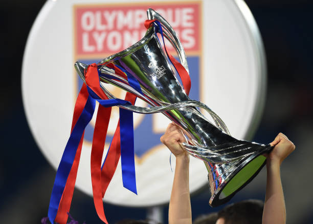 Olympique Lyonnais players hold aloft the trophy after winning the UEFA Women's Champions League Final 2017 in Cardiff, Wales. (Photo by Visionhaus/Corbis via Getty Images)
