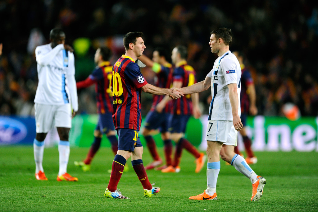 Messi shaking hands with James MIlner/ David Ramos/Getty Images