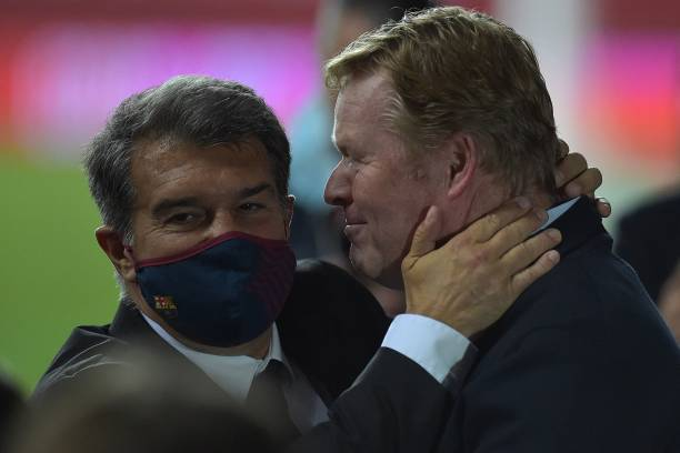 Ronald Koeman celebrates with Joan Laporta after winning the Copa del Rey final (Photo by CRISTINA QUICLER / AFP)