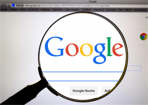 picture shows google through a magnifying glass