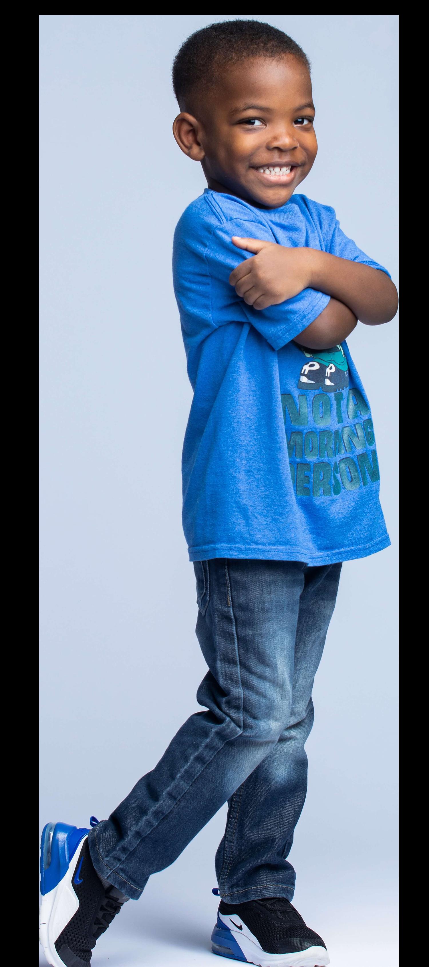 Kid in blue shirt-unsplash