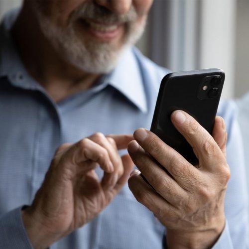 OlderMan-Phone-shutterstock_1877563882-1920x1080