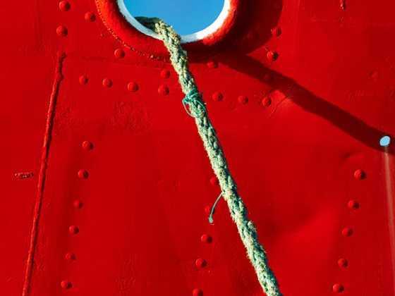 plakat med skibet Karoline og fortøjningstov