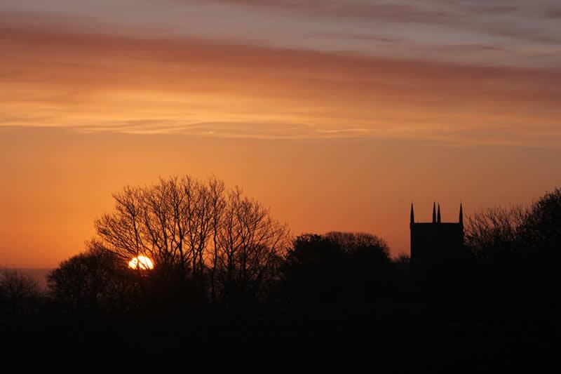 upper denby church at sunset
