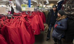 Customers look at a display of winter coats in a Sears store in Brooklyn. The company chairman, Eddie Lampert, has put in a bid to keep the business running in its entirety.