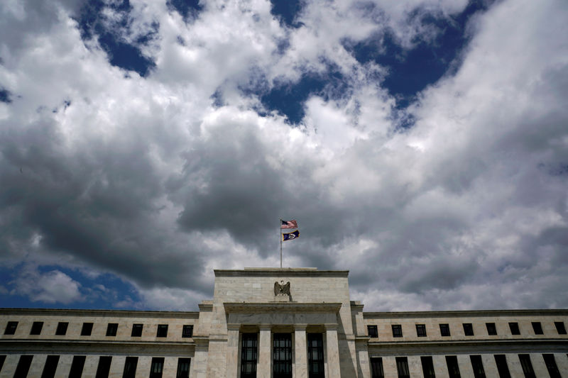 © Reuters. FILE PHOTO: FILE PHOTO: FILE PHOTO: Clouds over the Federal Reserve in Washington