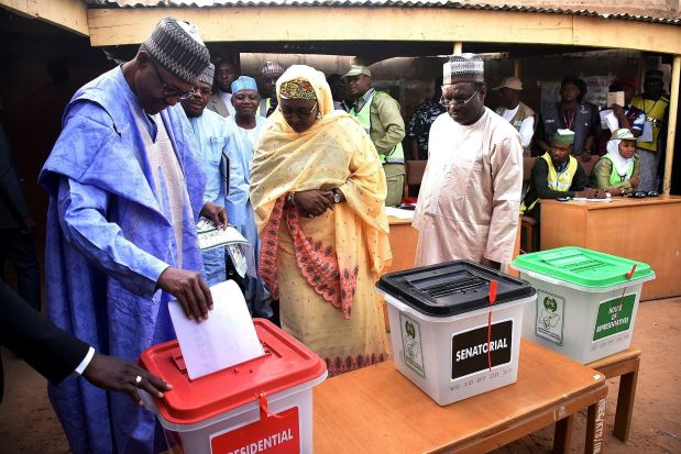Nigerian President Muhammadu Buhari casts his ballot in the presidential elections in Daura, Katsina.