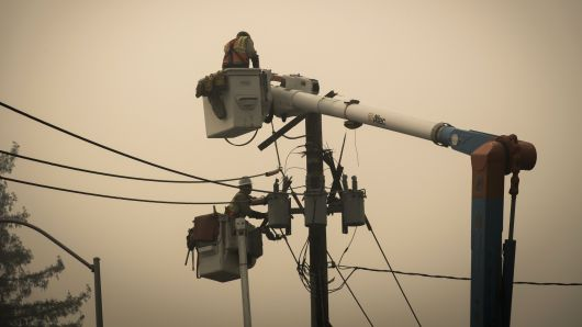 Pacific Gas & Electric Co. (PG&E) workers repair a transformer in Paradise, California, on Thursday, Nov. 15, 2018.