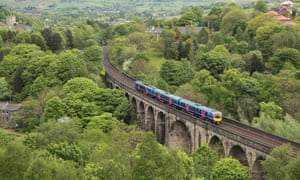 A TransPennine Express train crossing the viaduct at Brownhill, Dobcross. A similar vehicle will carry Burnley supporters to Newcastle for this evening's game