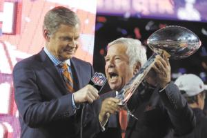 During a happier day, New England owner Bob Kraft, right, is interviewed after the Patriots won the Super Bowl on Feb. 1, 2015 in Glendale, Ariz.  AP