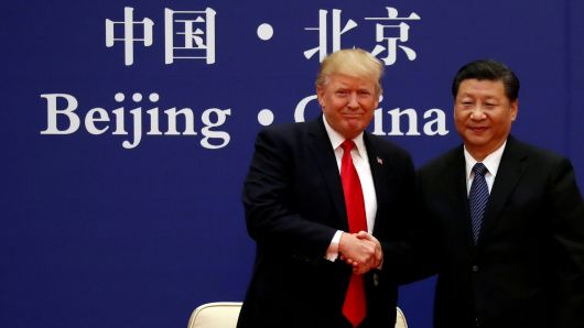 President Donald Trump and China's President Xi Jinping meet business leaders at the Great Hall of the People in Beijing, China, November 9, 2017.