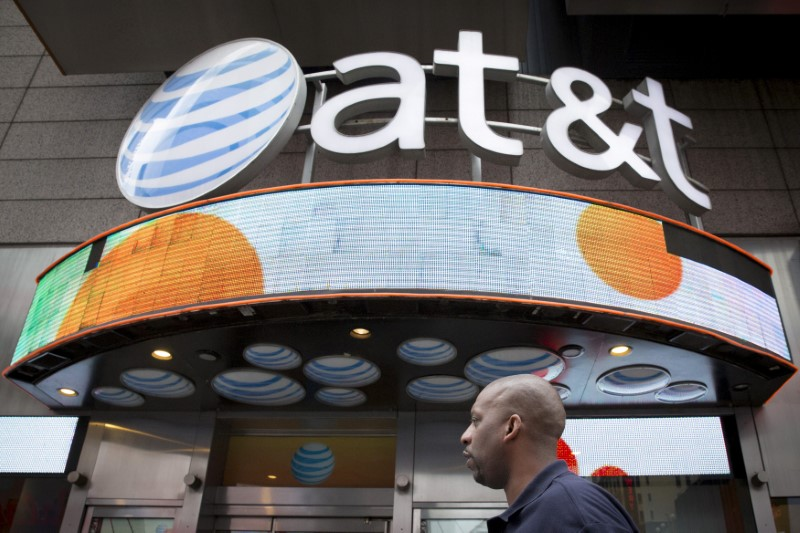 © Reuters. FILE PHOTO: A man walks past the AT&T store in New York's Times Square