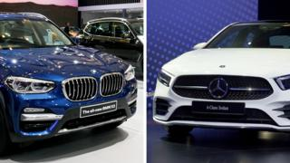 A BMW and Mercedes