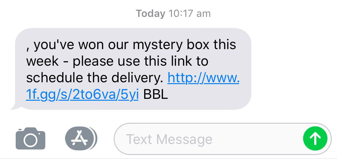 """A scam text message that reads: """"you've won our mystery box this week"""", and encourages the reader to click a link."""