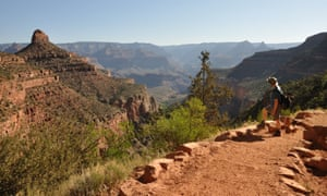A hiker pauses near the top of the Bright Angel Trail.