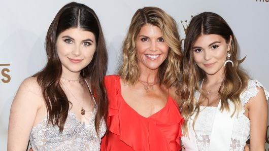 Actress Lori Loughlin (C) and her daughters Isabella Rose (L) and Olivia Jade Giannulli (R) attend the Hallmark Channel And Hallmark Movies And Mysteries 2017 Summer TCA Tour at on July 27, 2017 in Beverly Hills, California.