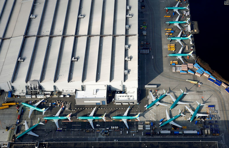 © Reuters. FILE PHOTO: An aerial photo shows Boeing 737 MAX airplanes parked on the tarmac at the Boeing Factory in Renton