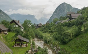 'All clouds spilling over nearby mountains and long sloping roofs': a village in the Bohinj region.