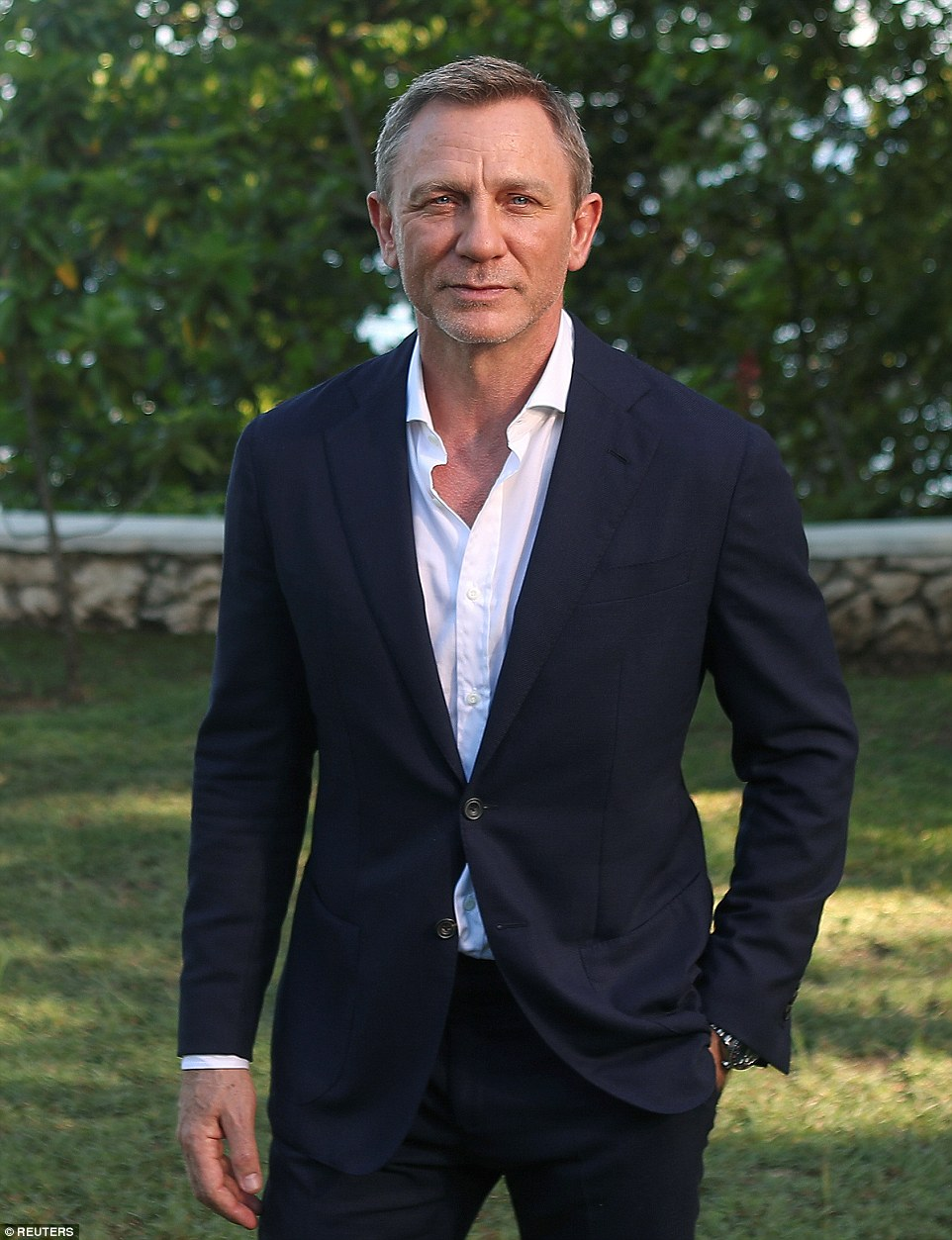 """Actor Daniel Craig poses for a picture during a photocall for the British spy franchise's 25th film set for release next year, titled """"Bond 25"""" in Oracabessa, Jamaica in April"""