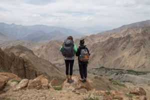 Two women looking to arid mountains in Ladakh, India