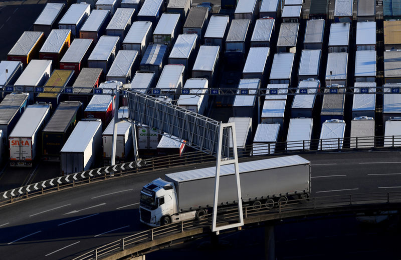 © Reuters. FILE PHOTO: A lorry is driven past dozens of others parked after traveling by ferry between Britain and France at the Port of Dover