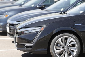 In this Thursday, Aug. 30, 2018, photograph, unsold 2019 Clarity sedans sit at a Honda dealership in Highlands Ranch, Colo.