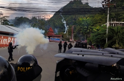 Riot police fire tear gas during a protest in Jayapura, Papua, Indonesia, Aug. 29, 2019 in this photo taken by Antara Foto.