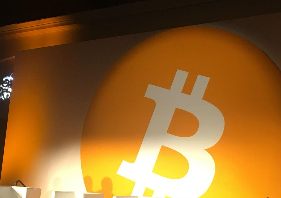 The Bitcoin logo behind the stage at Bitcoin Conference 2019.