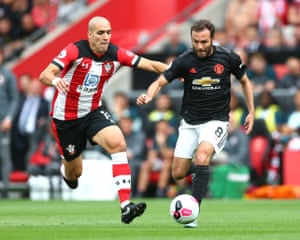 Juan Mata of Manchester United surges past Oriol Romeu of Southampton.