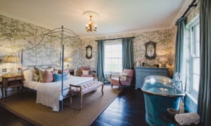 A bedroom at newly opened Elmley Farmhouse, with freestanding bath