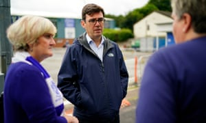 The mayor of Greater Manchester, Andy Burnham, talks to Bury fans outside Gigg Lane.