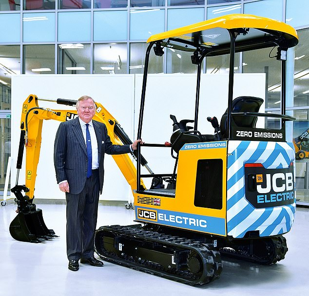 JCB has revealed record annual sales but said tough conditions lie ahead. Chairman Lord Bamford is pictured.
