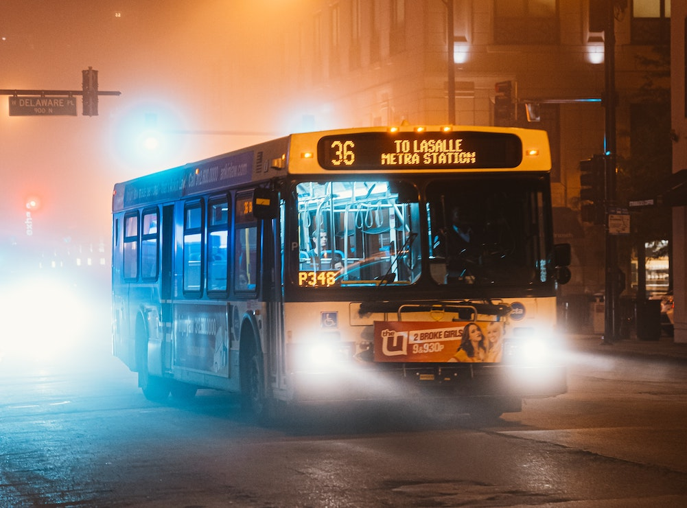 This picture show a Metra bus from Chicago on a foggy night.