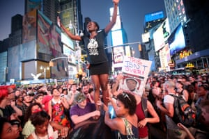 Trayvon Martin supporters rally in Times Square, New York, on July 14, 2013, after George Zimmerman was acquitted of all charges in the shooting to death of Martin