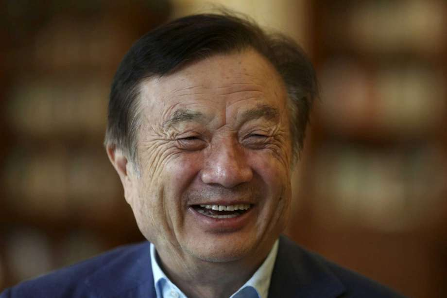 In this Aug. 20, 2019, photo, Huawei's founder Ren Zhengfei reacts as he chats with Huawei executives at the company campus in Shenzhen in Southern China's Guangdong province. Ren says its troubles with President Donald Trump are hardly the biggest crisis he has faced while working his way from rural poverty to the helm of China's first global tech brand. Photo: Ng Han Guan, AP / Copyright 2019 The Associated Press. All rights reserved.