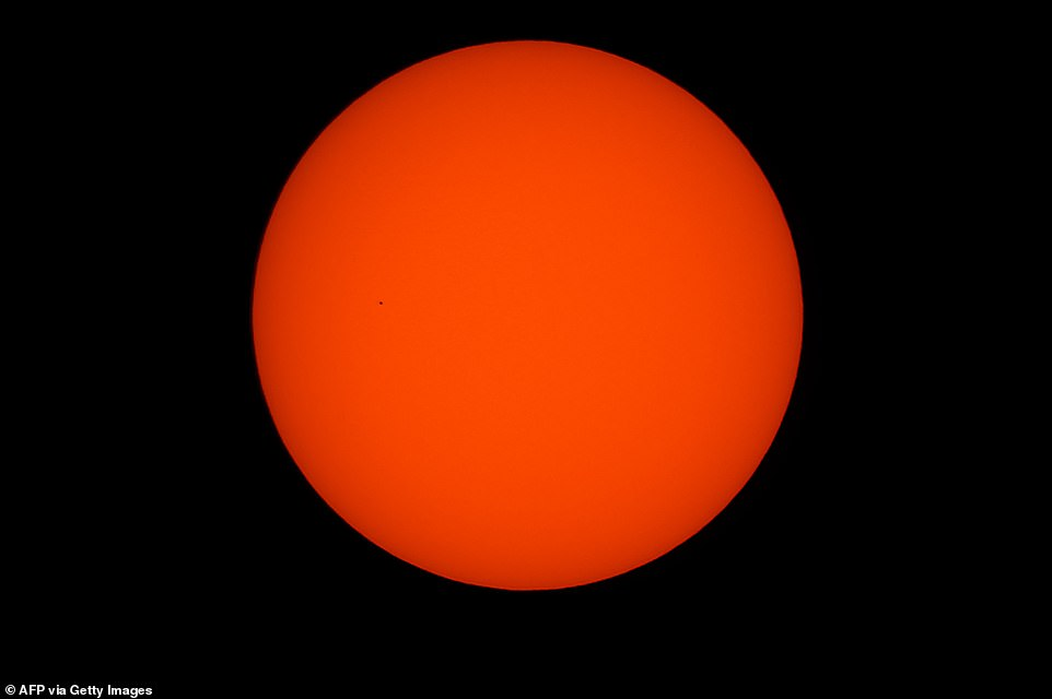 This photo of Mercury passing in front of a perfectly orange Sun was taken from Hédé-Bazouges in France, to north of Nantes in the country's west