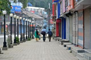 Indian tourists seen leaving the City during the curfew in Srinagar on 16 August 2019.