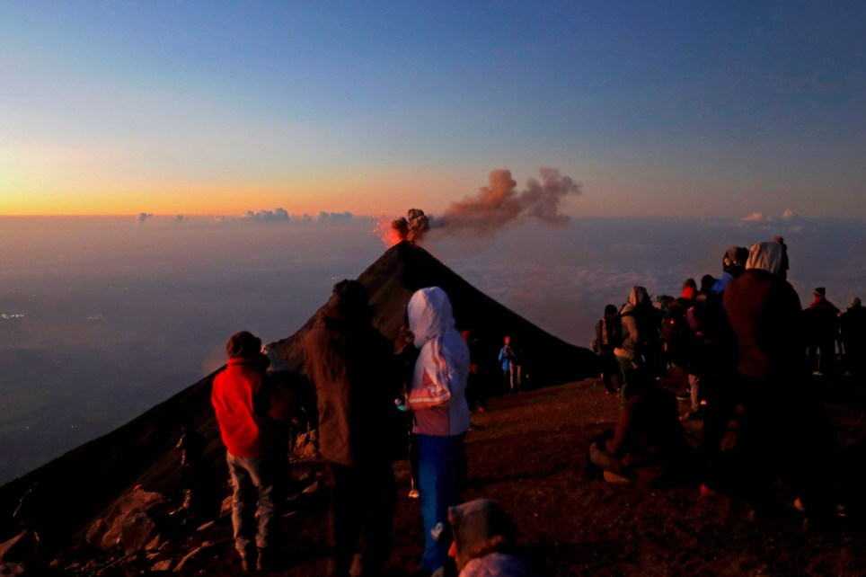 epa08039857 Tourists watch an eruption of Volcan de Fuego, or Chi Q'aq, volcano from atop the Acatenango volcano in Acatenango, Guatemala, 01 December 2019 (issued 02 December 2019). Acatenango volcano is one of the most visited by tourists in Guatemala, located in Chimaltenango department, his top is the most covet for adventurous for the sight to 'Volcano of Fire', which remains active and with constantly explosions. EPA/Esteban Biba
