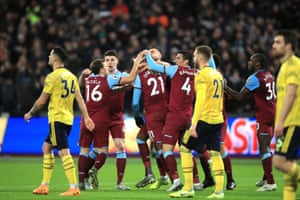 Ogbonna celebrates as the Arsenal players look dejected.