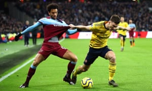 Arsenal's Kieran Tierney holds onto Felipe Anderson of West Ham United.