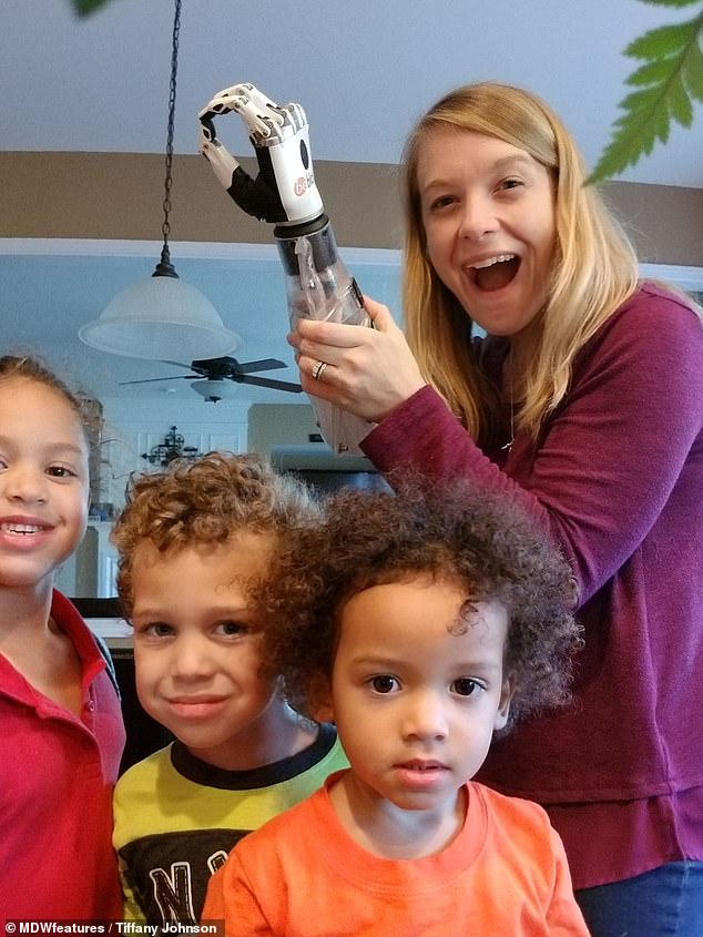 She was given several prosthetic limbs in the two years following the attack, all of which were basic and gave her limited dexterity in her arm. But she has returned to normal family life thanks to the new gadget (pictured)