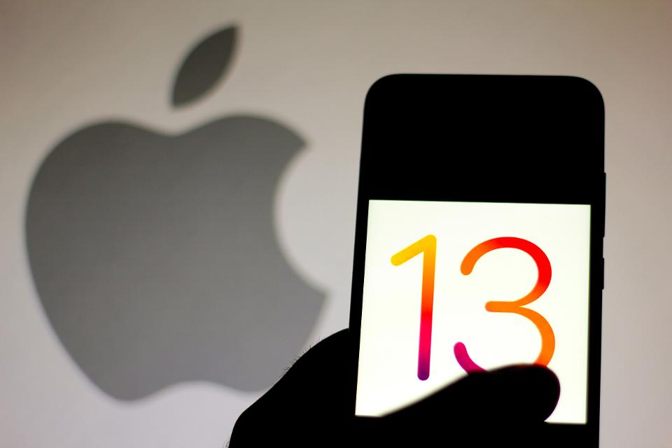 In this photo illustration the iOS 13 logo is seen displayed...