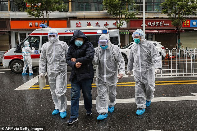 The Chinese government has historically tightly controlled the narrative of outbreaks like that of the SARS virus in 2003. Although some have praised its efficiency in adressing the current coronavirus outbreak, others have wondered if officials there have resisted foreign aid in order to conceal the extent of the outbreak. Pictured: A possible patient being escorted to a Wuhan hospital