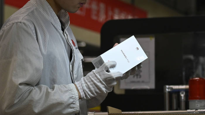 An employee works on a mobile phone production line at a Huawei production base during a media tour in Dongguan, China's Guangdong province on March 6, 2019. - Chinese telecom giant Huawei gave foreign media a peek into its state-of-the-art facilities on March 6 as the normally secretive company steps up a counter-offensive against US warnings that it could be used by Beijing for espionage and sabotage. (Photo by WANG ZHAO / AFP) (Photo credit should read WANG ZHAO/AFP via Getty Images)