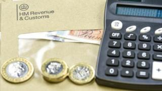 HMRC envelope, coins and calculator