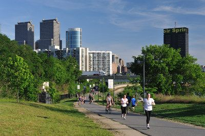 Philadelphia, USA - May 18, 2012. People doing exercise in Schuylkill Banks Park in the center city of Philadelphia, Pennsylvania. Philadelphia is the largest city in Pennsylvania and attracts lots of visitors for its historic landmarks like Independence Hall and Liberty Bell.