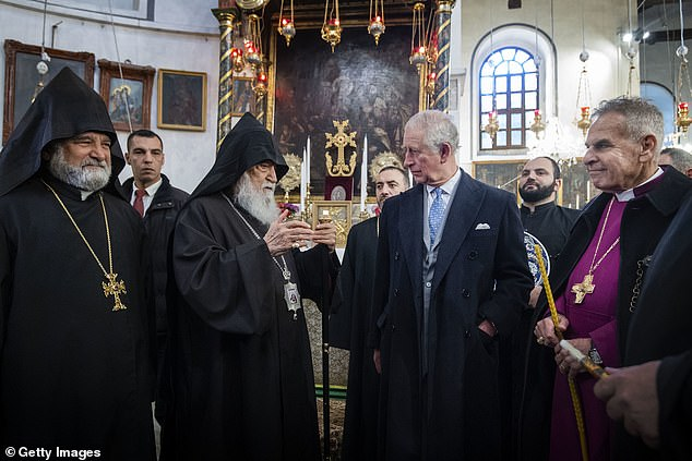 The Prince of Wales, pictured last week on a royal visit to Bethlehem, has also voiced alarm at what Huawei describes as its role 'in intelligent security innovation'