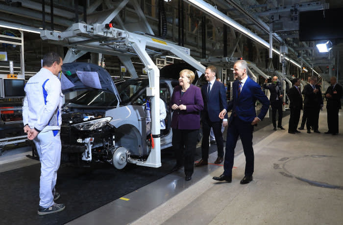Angela Merkel, Germany's chancellor, center left, Michael Kretschmer, premier of Saxony state, center, and Herbert Diess, chief executive officer of Volkswagen AG (VW), stand on the assembly line as VW begins mass-production of the ID.3 electric automobile in Zwickau, Germany, on Monday, Nov. 4, 2019. Merkel's visit to a revampedVW electric-car plant inZwickauon Monday is a stark reminder of what's at stake both for the German chancellor and VW bossDiess. Photographer: Krisztian Bocsi/Bloomberg