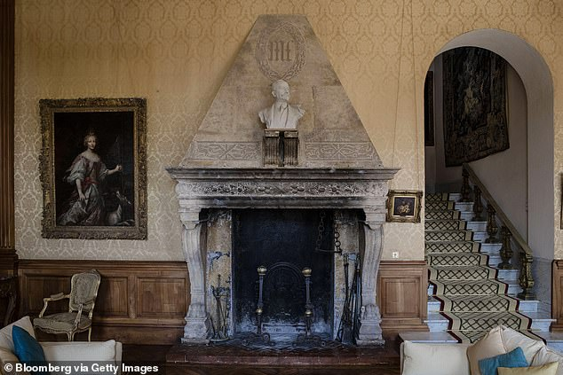 The initials M.L., for the Marnier-Lapostolle family, sit inscribed on a stonework of a fireplace inside the villa